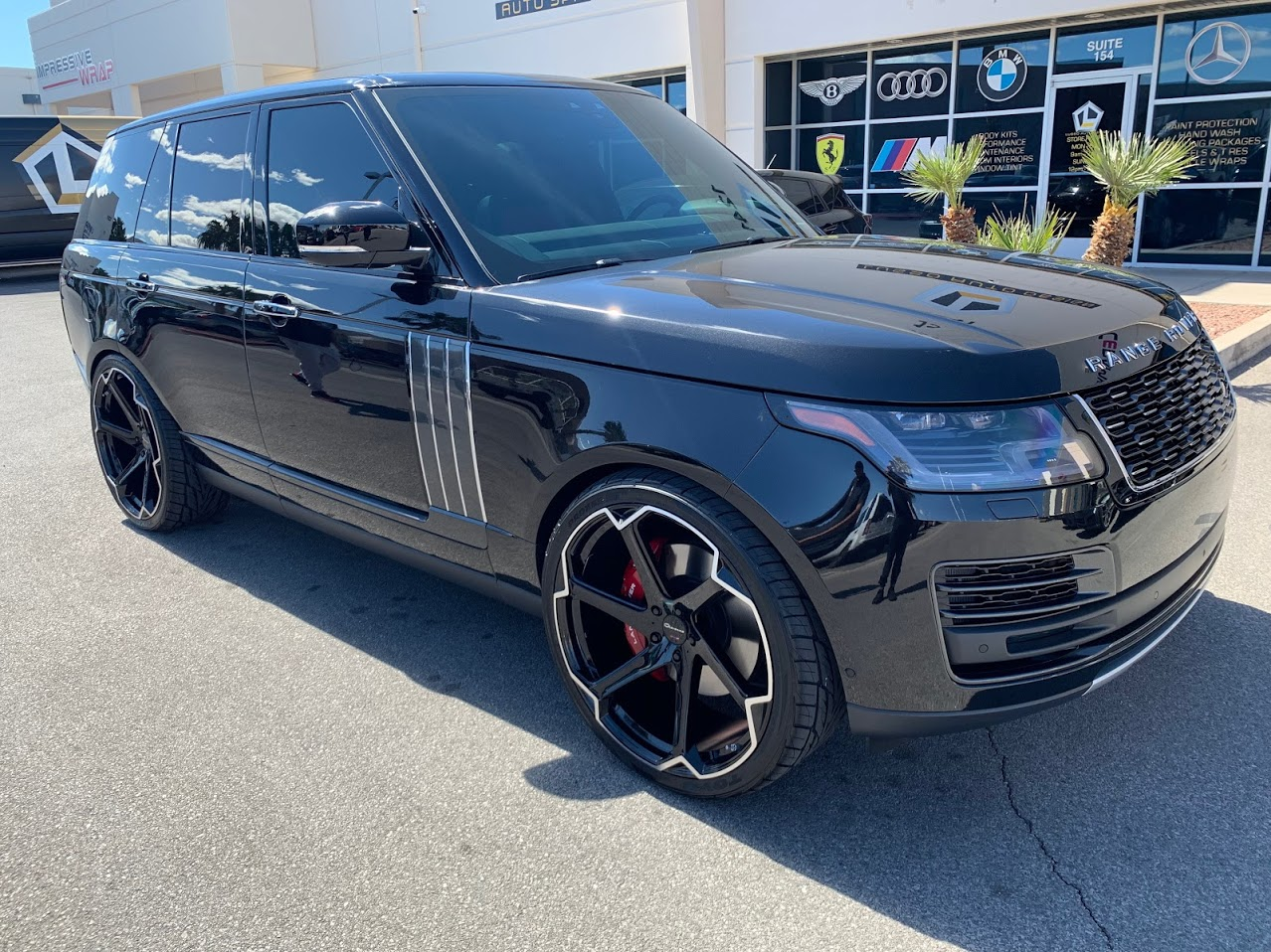 Giovanna Dalar X on Black Range Rover
